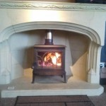 Jotul F100 M/F with Minsterstone 63&quot; Muchelney Fireplace
